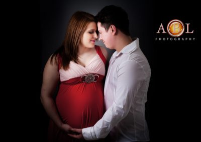 Maternity portrait couple lady in red