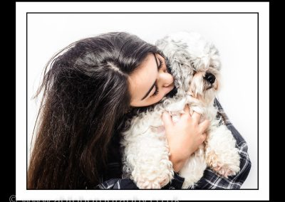 girl kissing a dog framed