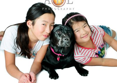 Sisters with a black dog